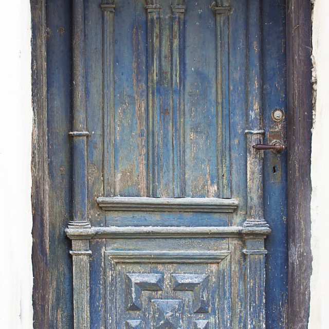 """Grunge door painted in blue worn and weathered"" stock image"