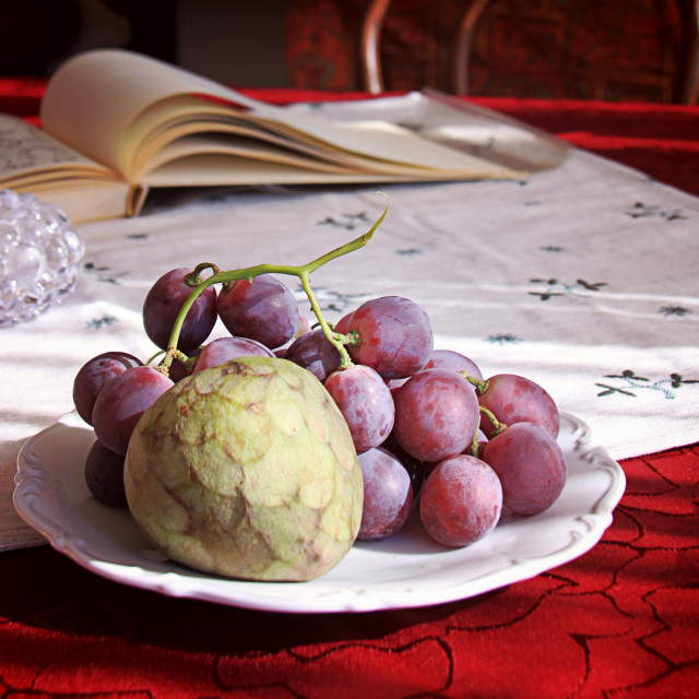"""""""Autumnal fruits on the table with blurred objects in background"""" stock image"""