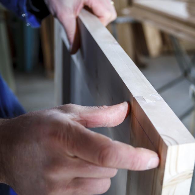"""""""Carpenter at work measuring"""" stock image"""
