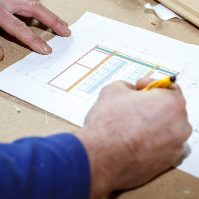 """Carpenter making drawings"" stock image"