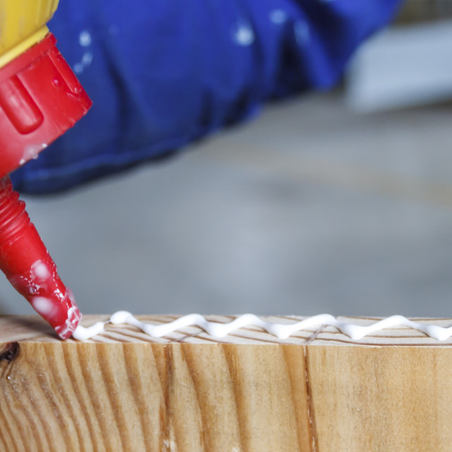 """""""Carpenter at work glueing"""" stock image"""