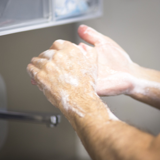 """Surgeon washing hands"" stock image"
