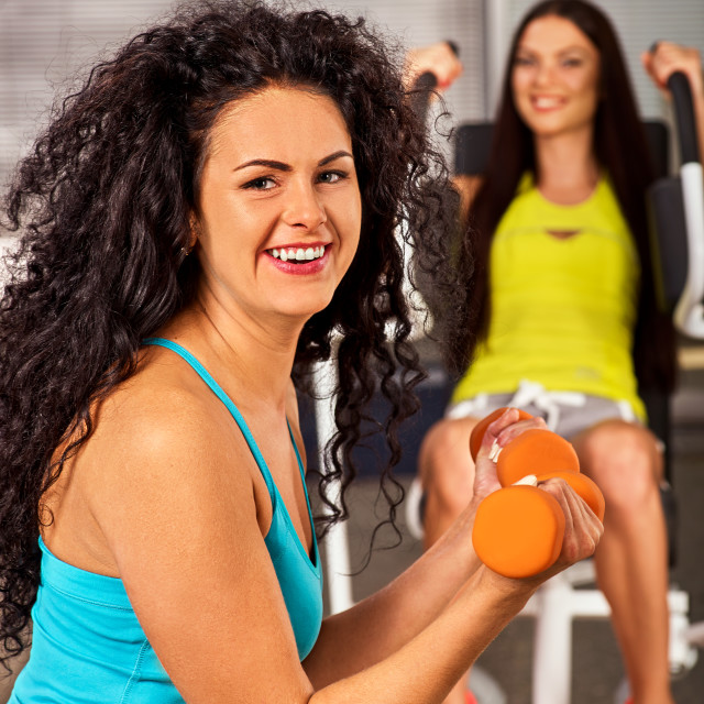 """Friends in gym workout with barbells. Fitness training women ."" stock image"