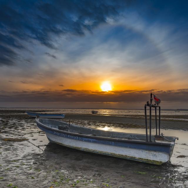 """Fishing boat at sunset"" stock image"