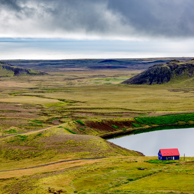 """Lonely blue house with red roof in Iceland"" stock image"
