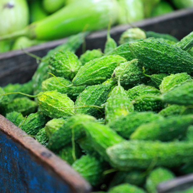 """Green paprica in traditional vegetable market in India."" stock image"