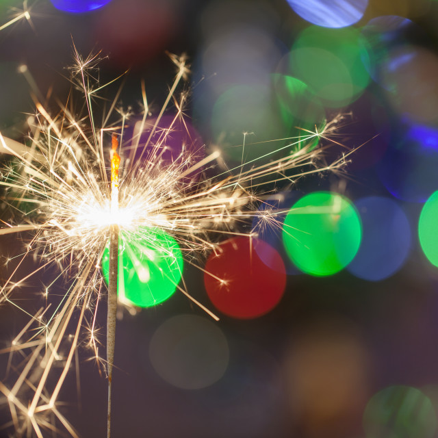 """Christmas sparkler with bokeh lights on the background. Close up"" stock image"