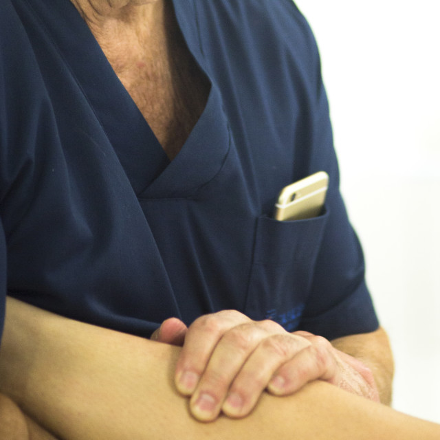 """""""Surgeon with knee mobility"""" stock image"""