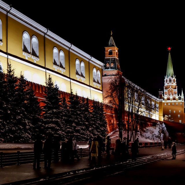 """MOSCOW, RUSSIA - January, 2017: Alexandrovsky garden near the Kremlin walls always looks spectacular lit at night on 8 january 2017"" stock image"