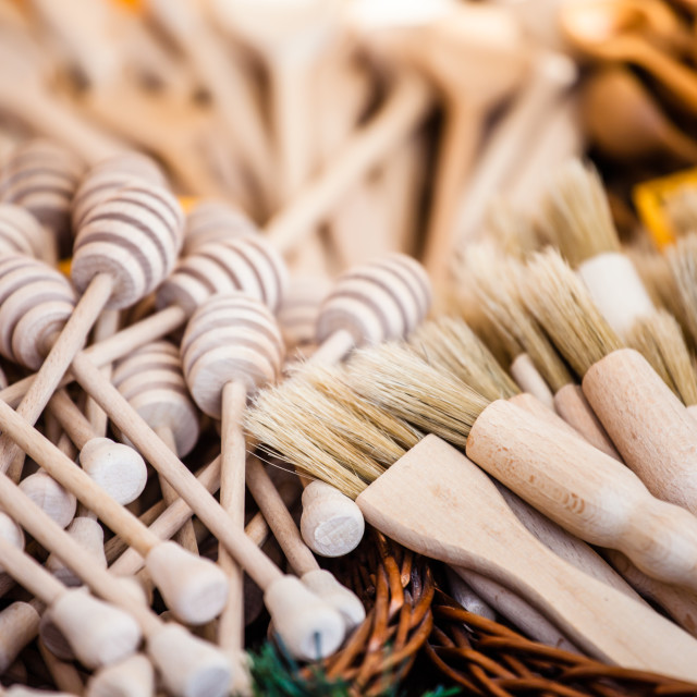 """Carved cups, spoons, forks and other utensils of wood"" stock image"