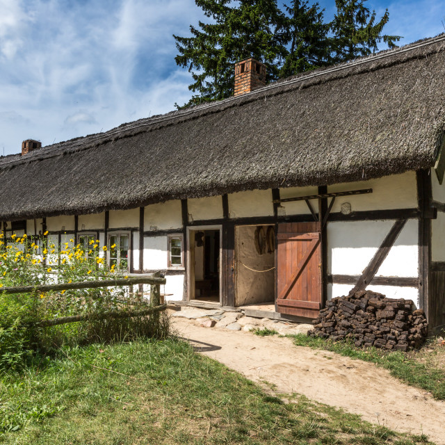 """Old wooden house in Kluki, Poland"" stock image"