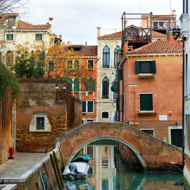 """Typical Venetian canal with bridge"" stock image"