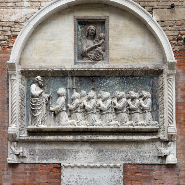 """Detail of a sculpture on the facade of the Scuola Grande di San Giovanni Evangelista, Venice"" stock image"