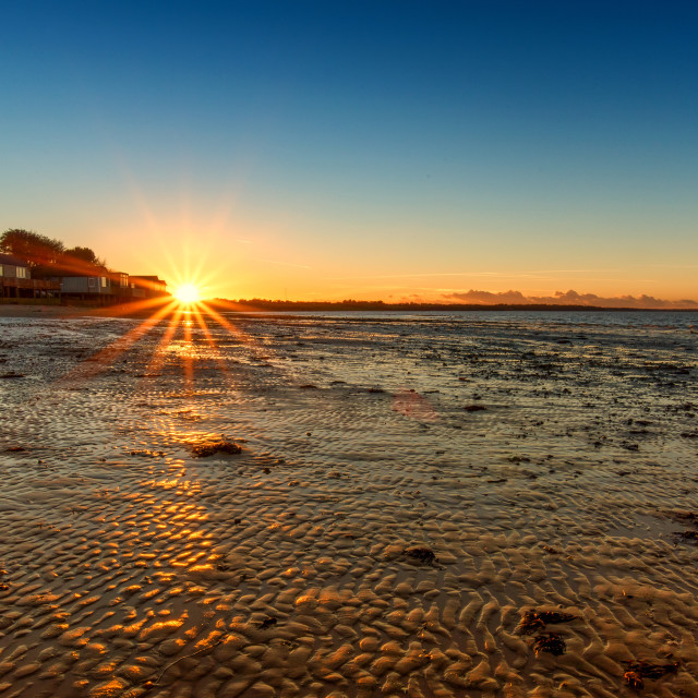 """Sunset at Wrabness Beach Essex"" stock image"