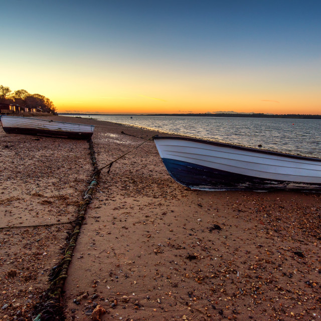 """Wintered Boats On Wrabness Beach"" stock image"