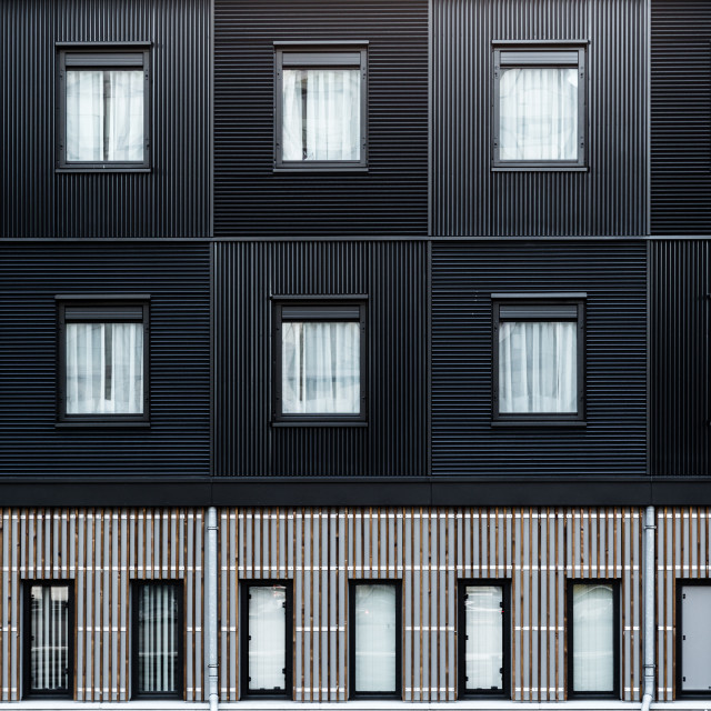"""Modern building wooden elevation made from black timbers"" stock image"