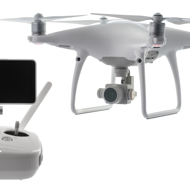 """Flying drone quadcopter isolated on white with clipping path"" stock image"