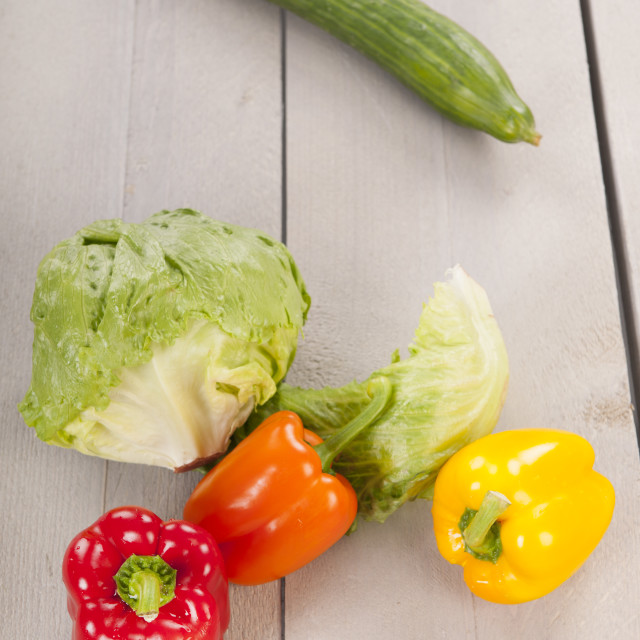"""Fresh vegetables on wooden background"" stock image"