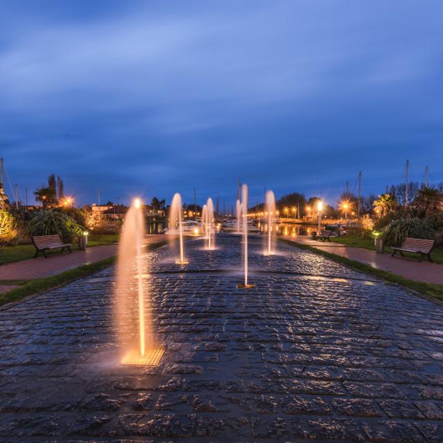 """Water fontain in Carentan,France at dusk"" stock image"
