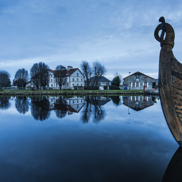 """""""wooden ship in Carentan quay with reflections in water"""" stock image"""