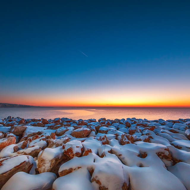 """""""Early morning with snow covered stones"""" stock image"""