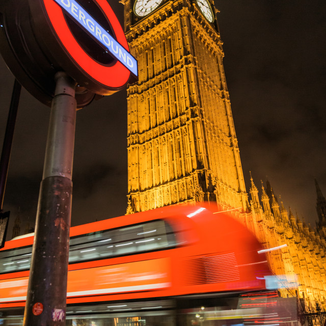 """London bus passing by big ben and westminster tube"" stock image"