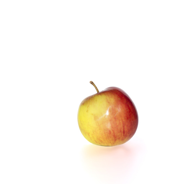 """small juicy red and yellow apple"" stock image"