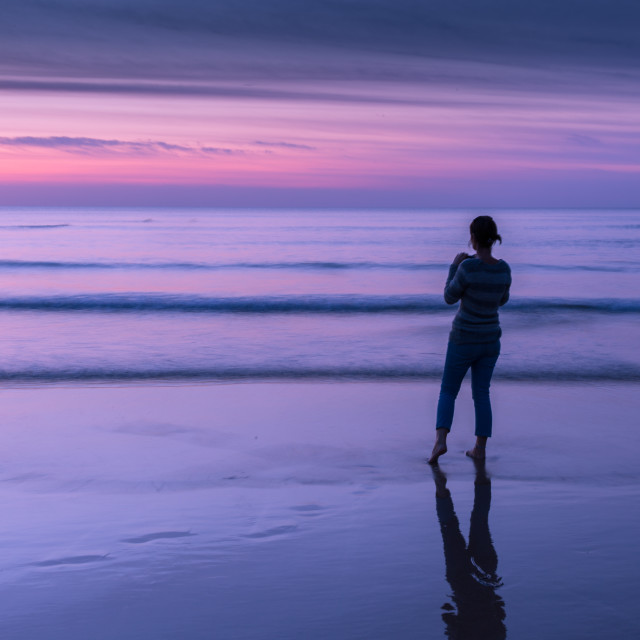"""""""Woman on beach looking out to sea"""" stock image"""