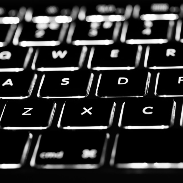 """Backlit computer keyboard closeup"" stock image"