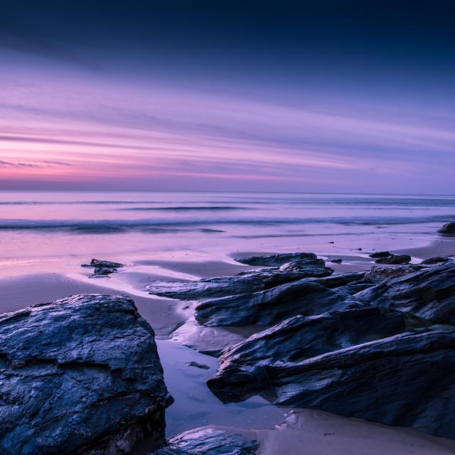 """Sunset on rocky beach"" stock image"