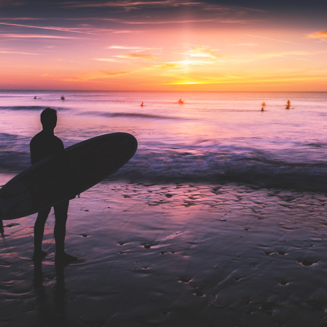 """""""Silhouette of surfer man standing on beach"""" stock image"""