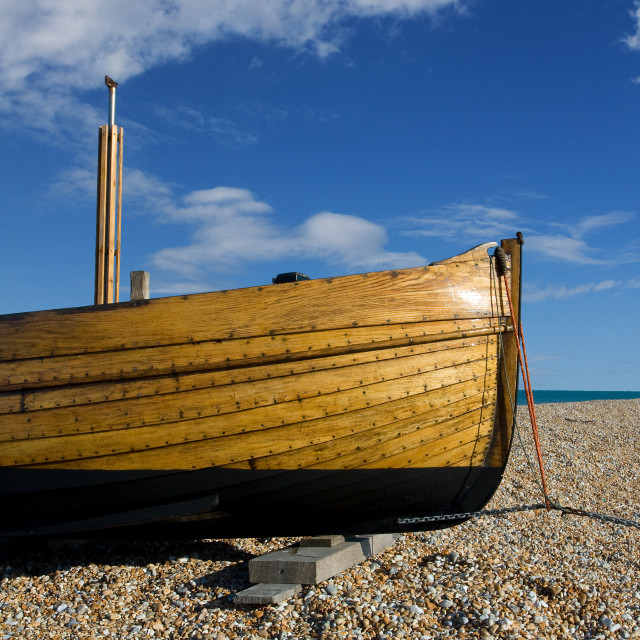 """Fishing boat on beach in England"" stock image"