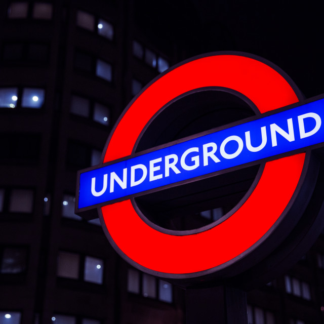 """London Underground sign at night"" stock image"