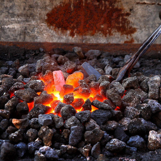 """Embers and Flame of a smith's forge"" stock image"