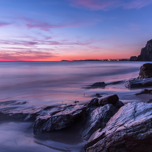 """Rocky coast and beach at sunset"" stock image"