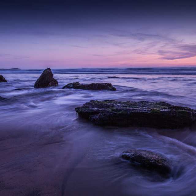 """""""Rocks in the sea at sunset"""" stock image"""