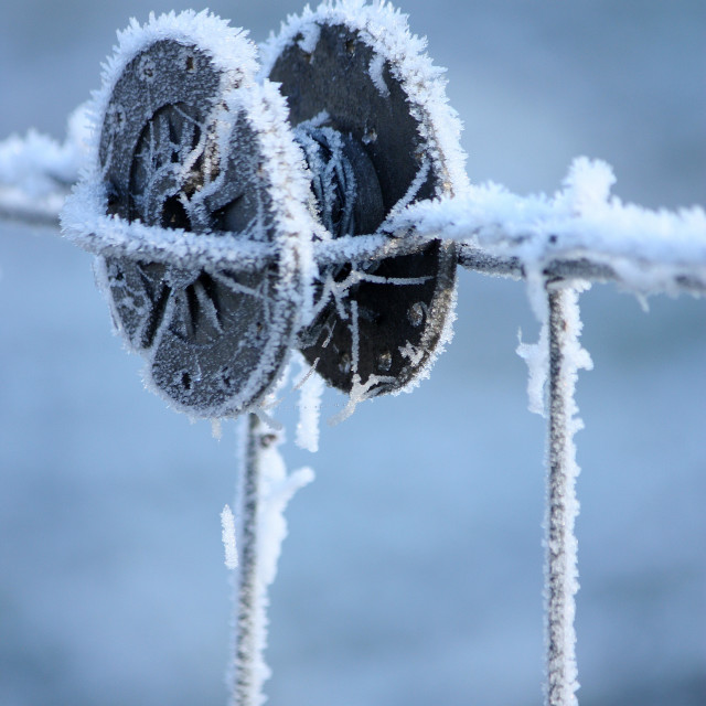 """Frozen barbed wire spool 1"" stock image"