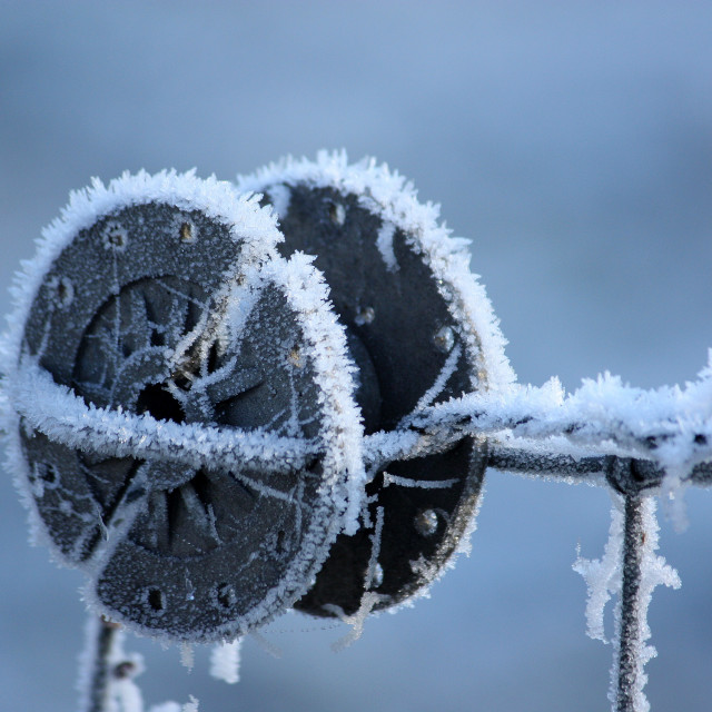 """Frozen barbed wire spool 3"" stock image"