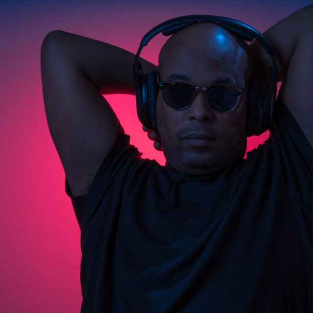 """African guy enjoying music in headphones"" stock image"