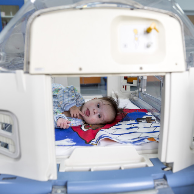 """""""Baby in an incubator smiling"""" stock image"""