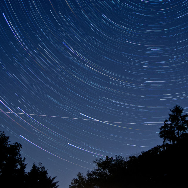 """""""Star Trail Comets"""" stock image"""