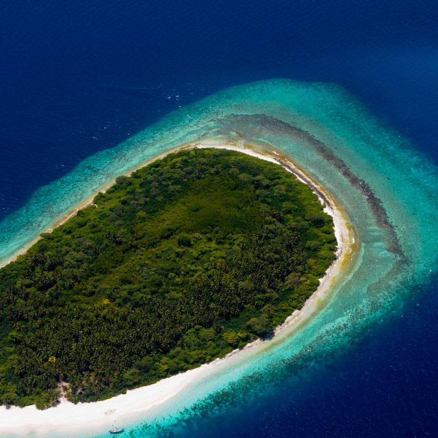"""Aerial view to Maldivian green desert island"" stock image"