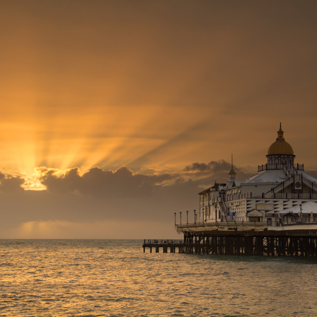 """Sunrise over Eastbourne Pier"" stock image"