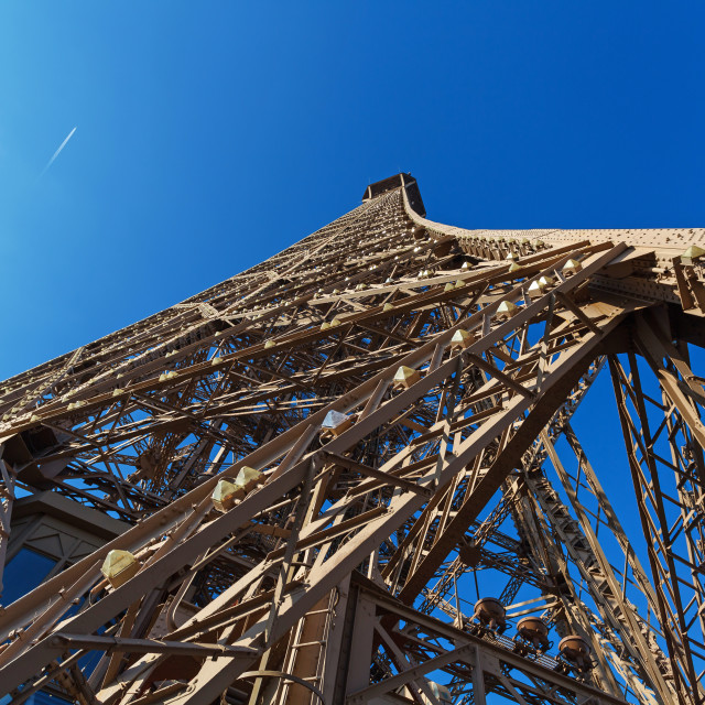 """""""Eiffel Tower in Paris, steel construction bottom view against clear blue sky"""" stock image"""
