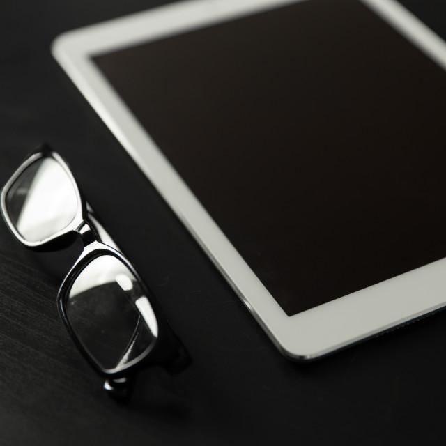 """White iPad and glasses"" stock image"
