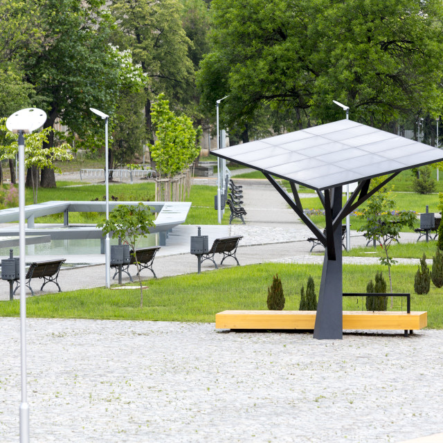 """Big solar station/panel in a park"" stock image"