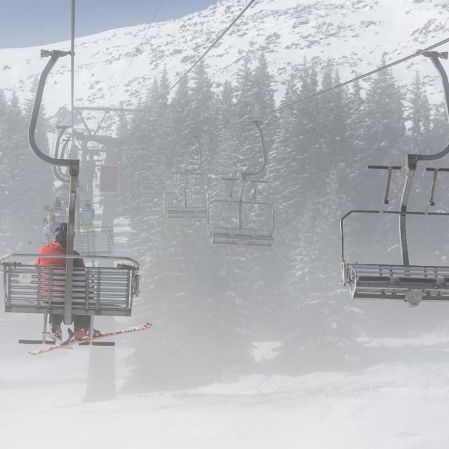 """""""Ski lift in fog"""" stock image"""