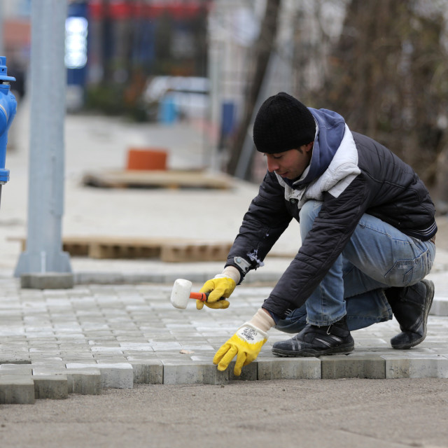 """""""Paving stone worker"""" stock image"""