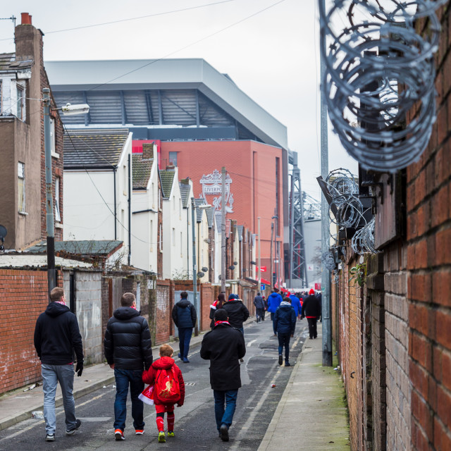 """Walking to the match"" stock image"