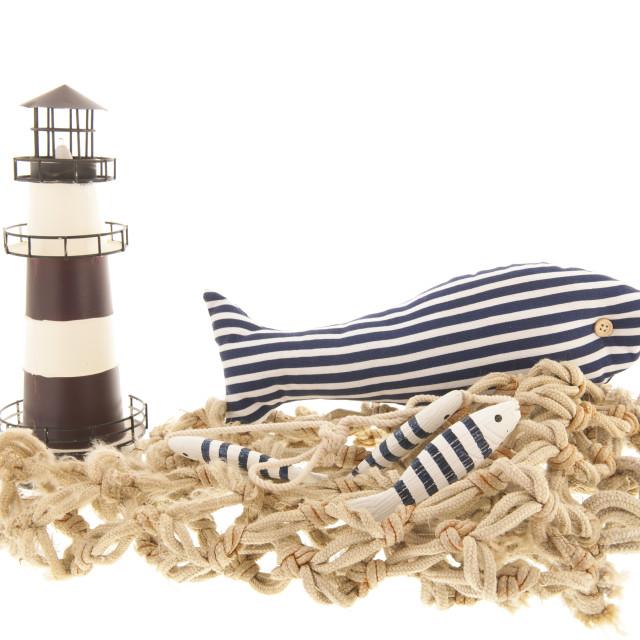 """Fishing net with lighthouse"" stock image"